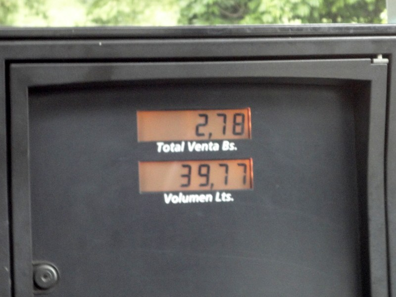 Total sale = [2.78 bolivars / 39.77 liters] * [$1 / 6.3 bolivars] * [3.77 gallons / 1 liter] = 4.3 cents / gallon at the official exchange rate of 6.3 bolivars per dollar, an artificially strong rate reserved for critical imports. At another official, less favorable exchange rate of $1 / 50 bolivars, gas costs a half-penny per gallon.