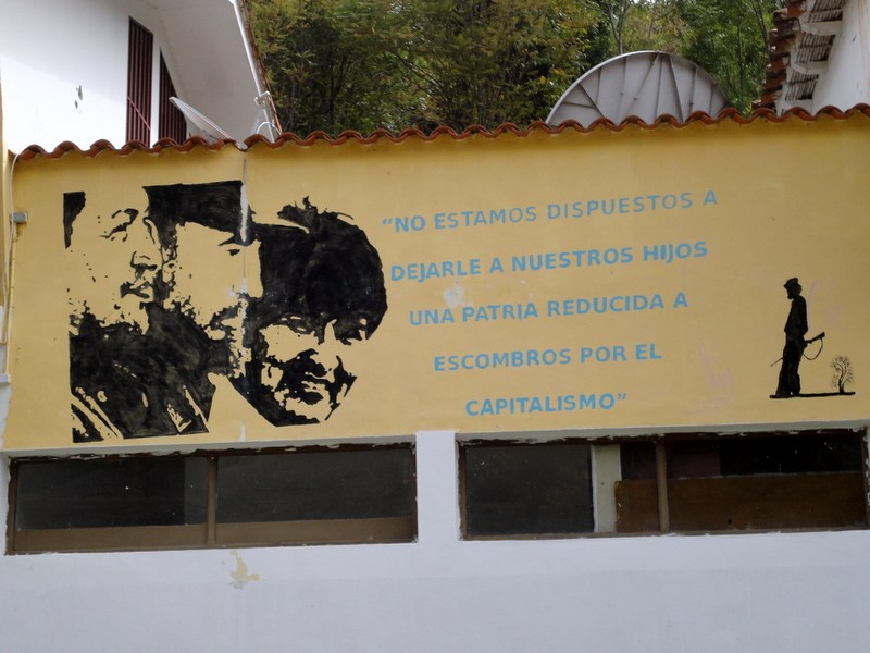 """Images of Hugo Chavez, Fidel Castro, and Evo Morales (President of Bolivia) in San Jose. """"We are not willing to leave to our children a country reduced to rubble by capitalism."""""""